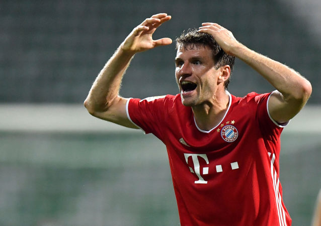 Bayern Munich's Thomas Muller reacts, following the resumption of play behind closed doors after the outbreak of the coronavirus disease (COVID-19)