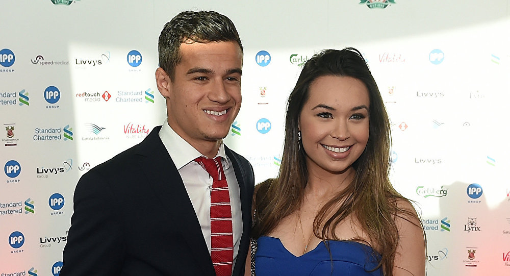 (File) Liverpool's Brazilian midfielder Philippe Coutinho an his wife Aine arrive to attend the Liverpool Football Club 2015 Players' Awards at the Echo Arena in Liverpool on May 19, 2015