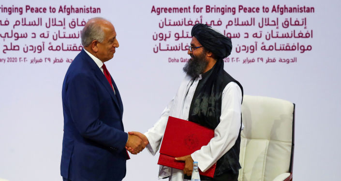 Mullah Abdul Ghani Baradar, the leader of the Taliban delegation, and Zalmay Khalilzad, U.S. envoy for peace in Afghanistan, shake hands after signing an agreement at a ceremony between members of Afghanistan's Taliban and the U.S. in Doha, Qatar February 29, 2020.