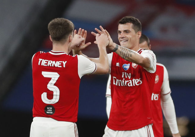 Soccer Football - FA Cup Semi Final - Arsenal v Manchester City - Wembley Stadium, London, Britain - July 18, 2020 Arsenal's Granit Xhaka and Kieran Tierney celebrate after the match, as play resumes behind closed doors following the outbreak of the coronavirus disease (COVID-19)
