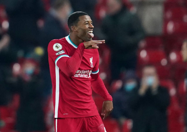 Soccer Football - Premier League - Liverpool v Wolverhampton Wanderers - Anfield, Liverpool, Britain - December 6, 2020 Liverpool's Georginio Wijnaldum celebrates scoring their second goal