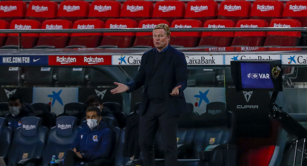 Barcelona's head coach Ronald Koeman gives instruction inside the box team area during the Spanish La Liga soccer match between FC Barcelona and Real Sociedad at the Camp Nou stadium in Barcelona, Spain, Wednesday, Dec. 16, 2020.