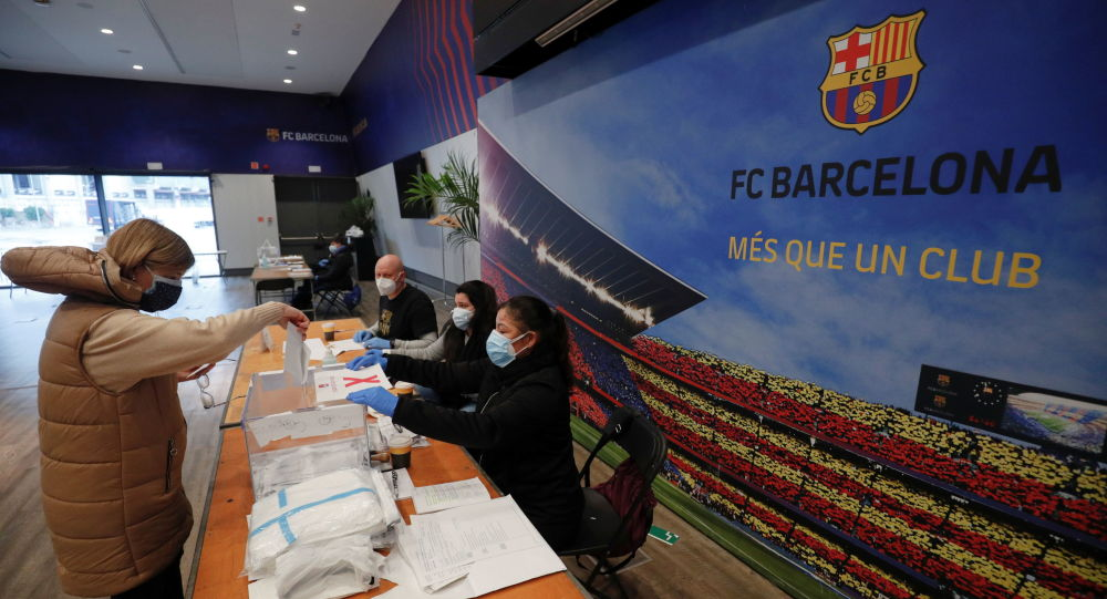 A woman casts her ballot in a polling station at FC Barcelona's Auditorium, next to Camp Nou stadium, during regional elections in Catalonia, amid the outbreak of the coronavirus disease (COVID-19), in Barcelona, Spain, 14 February 2021. REUTERS/Albert Gea