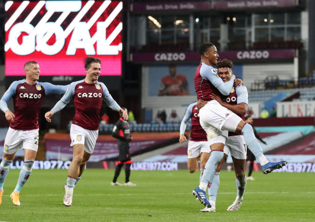 Aston Villa's Ollie Watkins celebrates scoring their fourth goal and completing his hat-trick with Ezri Konsa and teammates