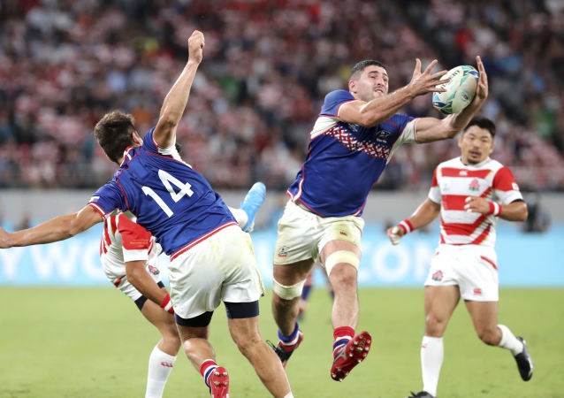 Russia's Tagir Gadzhiev jumps to catch a ball during the Rugby World Cup's opening game against Japan