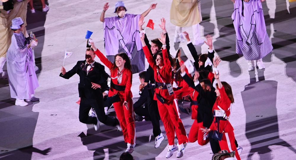 Russian athletes, members of the Russian national team (ROC team) are photographed at the athletes parade at the opening ceremony of the XXXII Summer Olympic Games in Tokyo