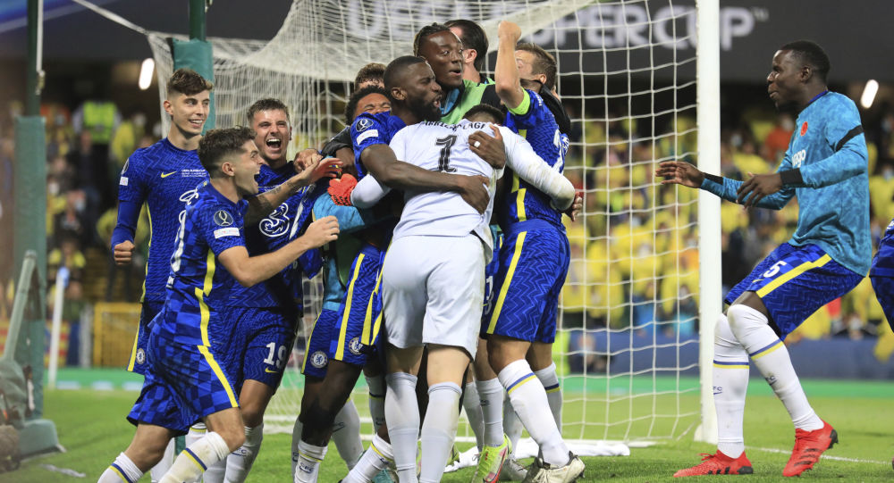 Chelsea's goalkeeper Kepa Arrizabalaga celebrates with team mates after the penalty shootout of the UEFA Super Cup soccer match between Chelsea and Villarreal at Windsor Park in Belfast, Northern Ireland, Wednesday, Aug. 11, 2021