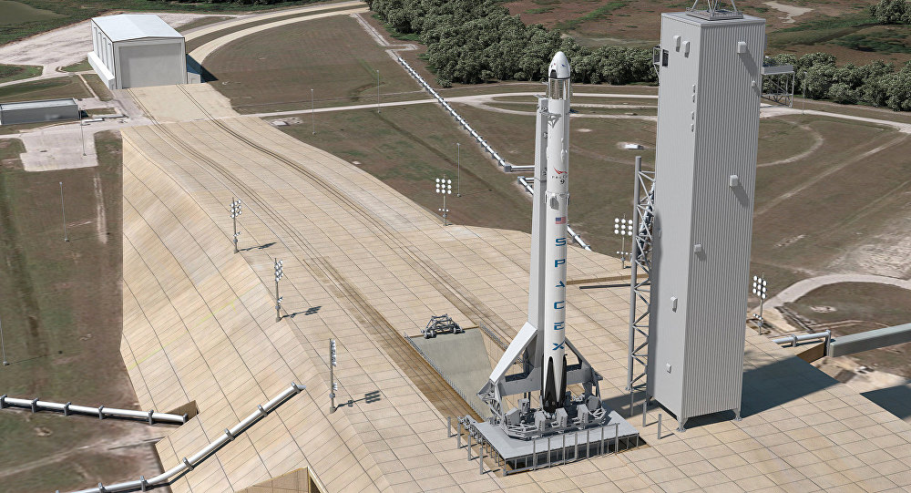 This artist's concept shows Launch Complex 39A at NASA's Kennedy Space Center in Florida as it will appear for the launch of a SpaceX Crew Dragon spacecraft atop a Falcon 9 rocket. SpaceX is modifying the launch pad to host Falcon 9 and Falcon Heavy launch vehicles