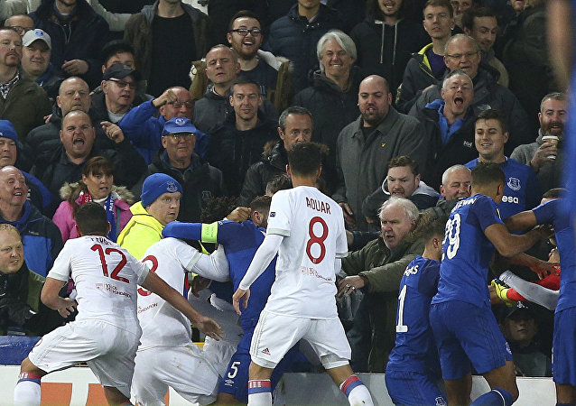 Everton, in blue, and Lyon players clash during a Group E Europa League soccer match between Everton F.C. and Olympique Lyon at Goodison Park Stadium, Liverpool, England