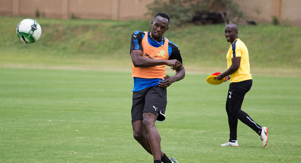 Former Olympic sprinter Usain Bolt attends a practice session with Mamelodi Sundowns soccer team in Johannesburg, South Africa, January 29, 2018