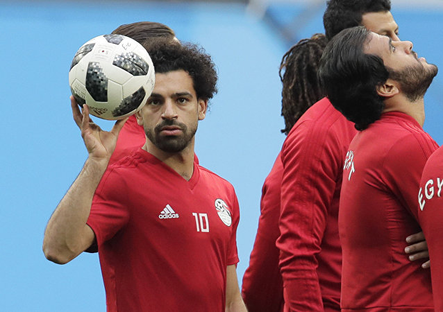 Egypt's Mohamed Salah, left, plays with the ball during Egypt's official training on the eve of the group A match between Russia and Egypt at the 2018 soccer World Cup in the St. Petersburg stadium in St. Petersburg, Russia, Monday, June 18, 2018