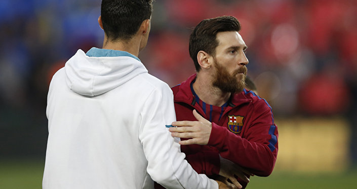 Barcelona's Lionel Messi, right and Real Madrid's Cristiano Ronaldo greets each other before a Spanish La Liga soccer match between Barcelona and Real Madrid, dubbed 'el clasico', at the Camp Nou stadium in Barcelona, Spain, Sunday, May 6, 2018