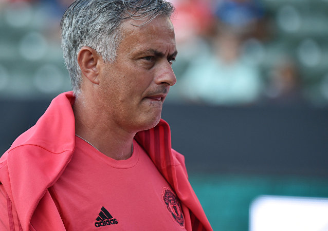 Manchester United's coach Jose Mourinho walks on the pitch before the start of the International Champions Cup match between Manchester United and AC Milan at the StubHub Center in Carson, California, on July 25, 2018