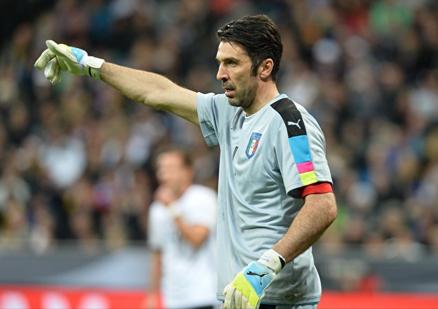 Italy goalkeeper Gianluigi Buffon calls for teammates' attention during a friendly soccer match between Germany and Italy at the Allianz Arena in Munich, March 29, 2016