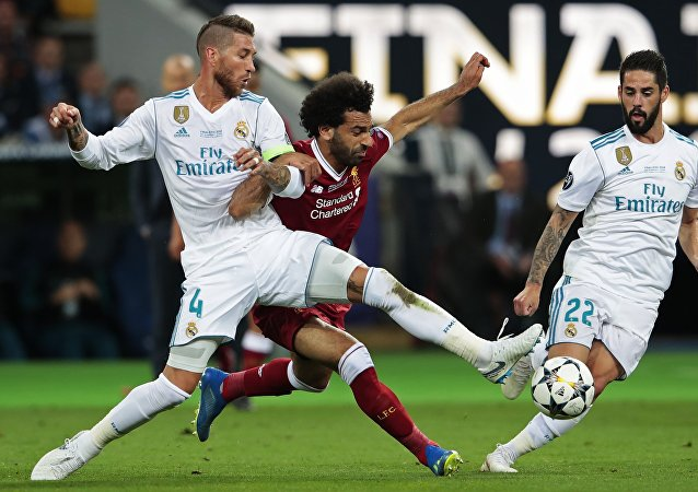 From left: Sergio Ramos from Real Madrid FC (Madrid, Spain), Mohamed Salah from Liverpool FC (Liverpool, England) and Isco from Real Madrid FC during the 2017-2018 UEFA Champions League final match between Liverpool FC and Real Madrid FC