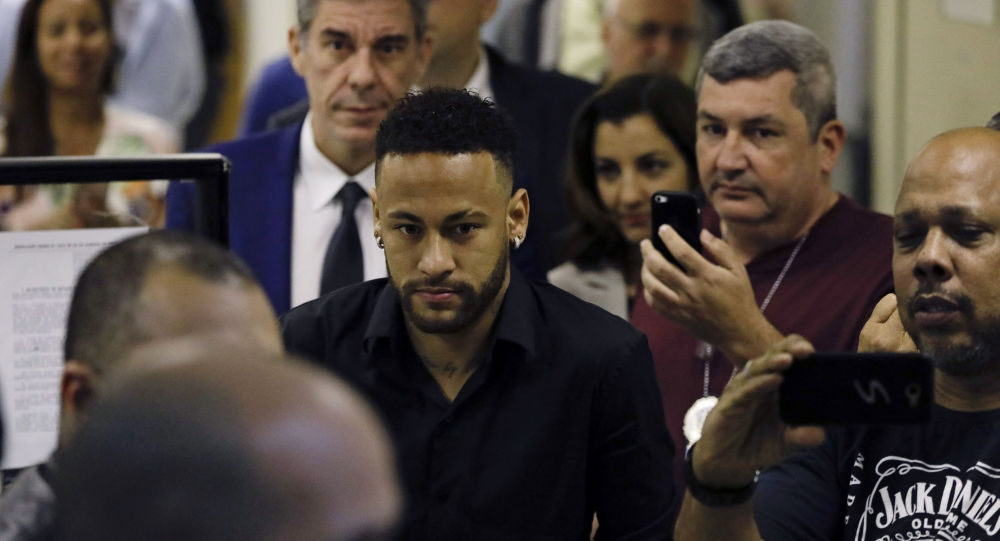 Brazilian soccer player Neymar leaves police headquarters in Rio de Janeiro, Brazil, Thursday, June 6, 2019. Neymar went to the headquarters in an investigation linked to a woman's rape allegation against him.