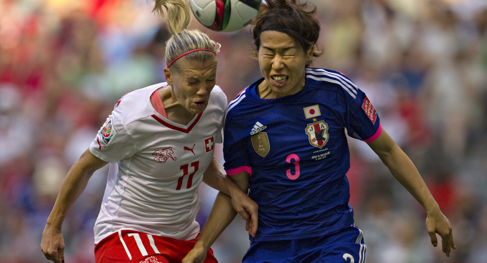 Switzerland forward Lara Dickenmann (L) and Japan defender Azusa Iwashimizu head the ball during a Group C football match between Switzerland and Japan at BC Place Stadium in Vancouver during the FIFA Women's World Cup Canada 2015 on June 8, 2015