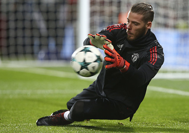 Manchester United goalkeeper David de Gea warms up before the Champions League group A soccer match between Manchester United and Benfica, at Old Trafford, in Manchester, England, Tuesday, Oct. 31, 2017