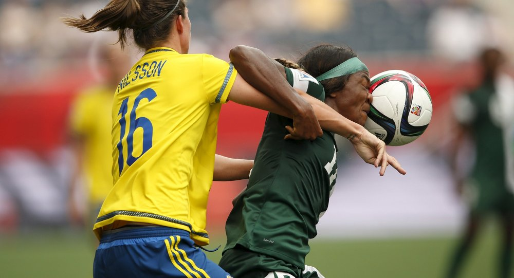 Nigeria forward Francisca Ordega (17) heads a ball against Sweden defender Lina Nilsson (16) in a Group D soccer match in the 2015 women's World Cup at Winnipeg Stadium.