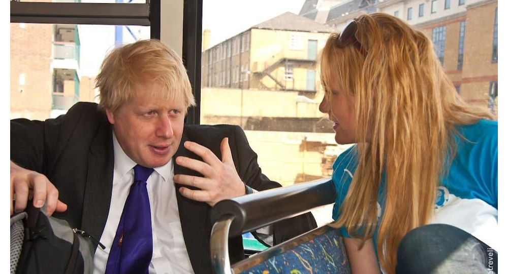 Boris Johnson and Jennifer Arcuri speak on the campaign bus in 2012.