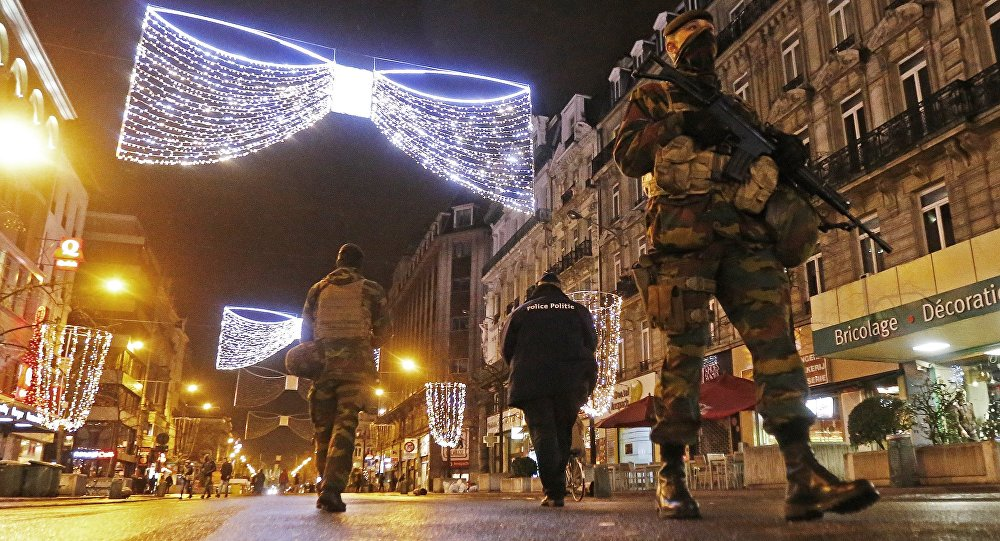 Belgian soldiers and police patrol in central Brussels on November 22, 2015, after security was tightened in Belgium following the fatal attacks in Paris