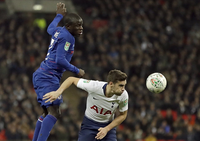 Tottenham's Harry Winks, right, and Chelsea's N'Golo Kante jump for the ball during the English League Cup semifinal first leg soccer match between Tottenham Hotspur and Chelsea at Wembley Stadium in London, Tuesday, Jan. 8, 2019