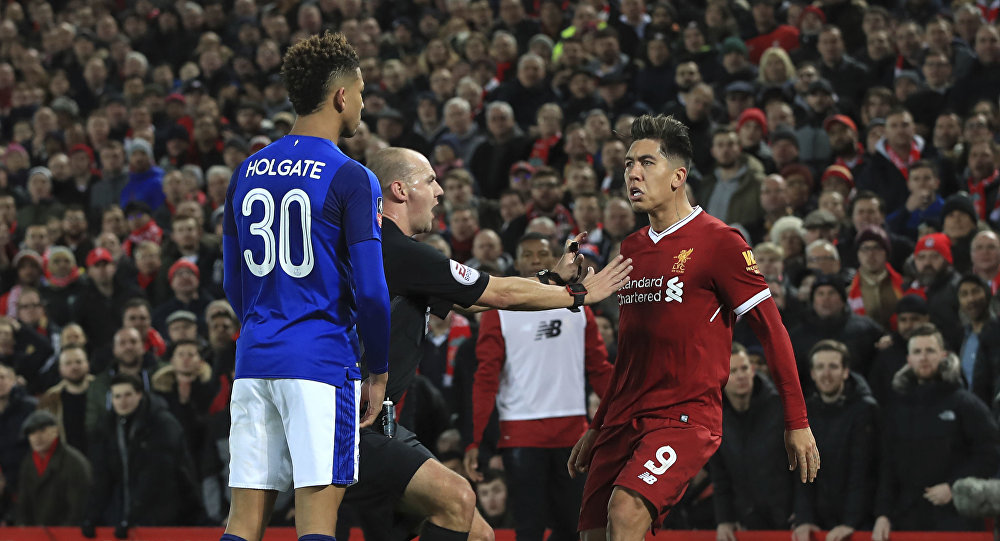 Tempers flare between Everton's Mason Holgate, left, and Liverpool's Roberto Firmino during the English FA Cup Third Round soccer match between Liverpool and Everton at Anfield in Liverpool, England, Friday, Jan. 5, 2018