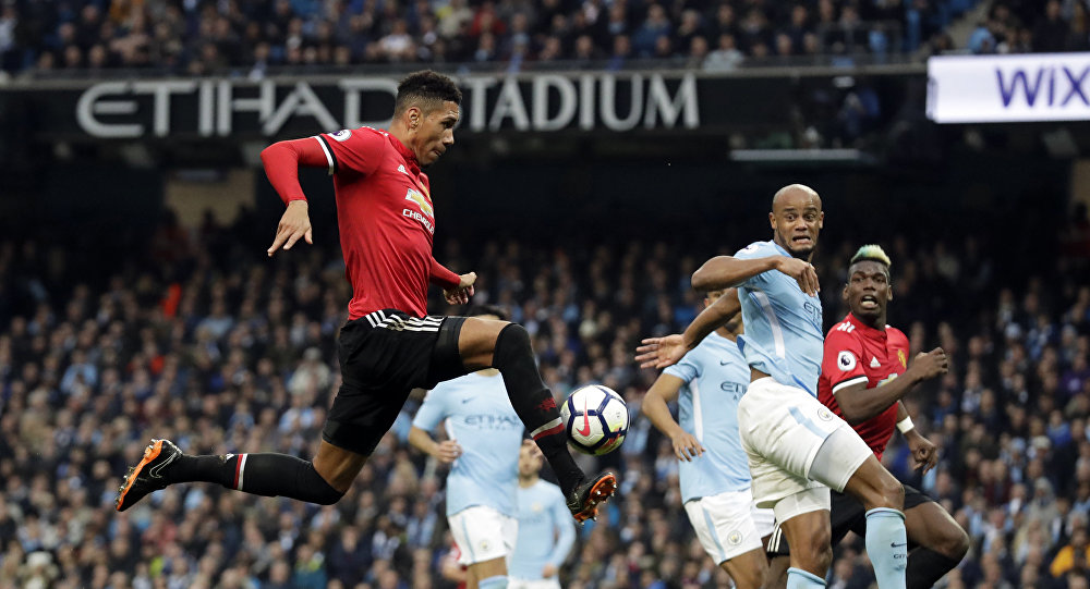 Manchester United's Chris Smalling, left, scores his side's third goal during the English Premier League soccer match between Manchester City and Manchester United at the Etihad Stadium in Manchester, England, Saturday April 7, 2018
