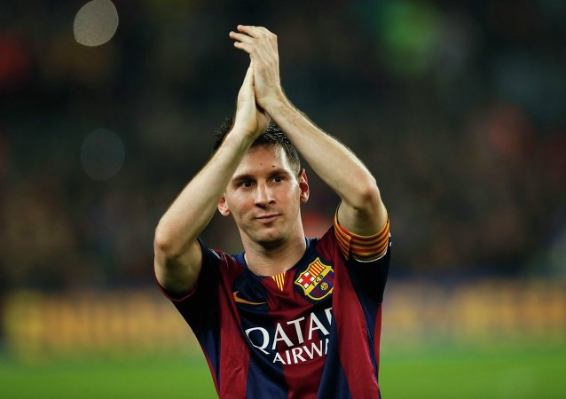 Barcelona's Lionel Messi celebrates at the end of their Spanish first division soccer match against Sevilla at Nou Camp stadium in Barcelona November 22, 2014