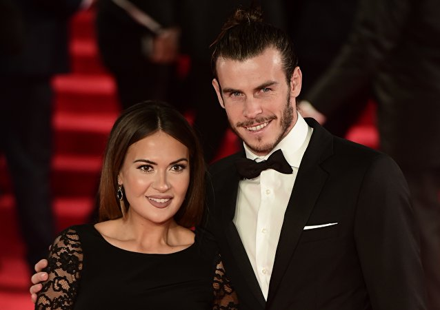 Welsh footballer Gareth Bale (R) and his partner Emma Rhys Jones pose on arrival for the world premiere of the new James Bond film 'Spectre' at the Royal Albert Hall in London on October 26, 2015